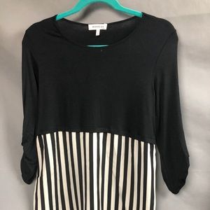 Top with half flowy black and white stripe bottom